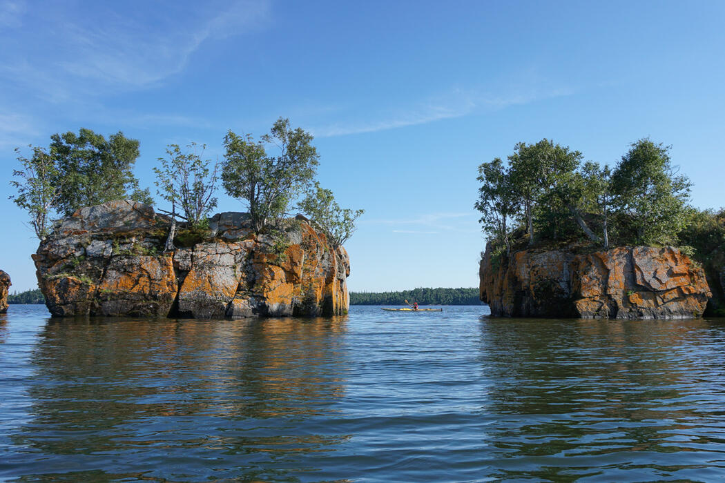 Two small rock islands with trees