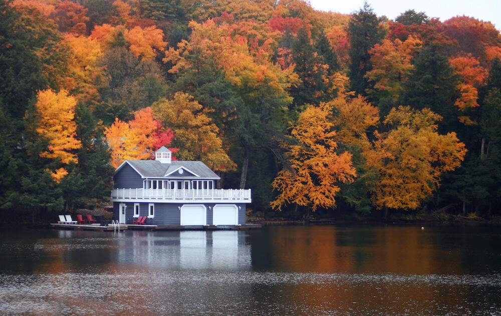 Boathouse on lake with fall leaves