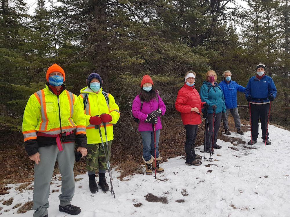 Group of hikers wearing masks in the winter