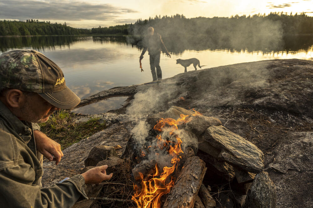 The quintessential Quetico night, with a rocky bluff to situate your fire at sunset and fresh fish ready for the cast iron. Photo: David Jackson