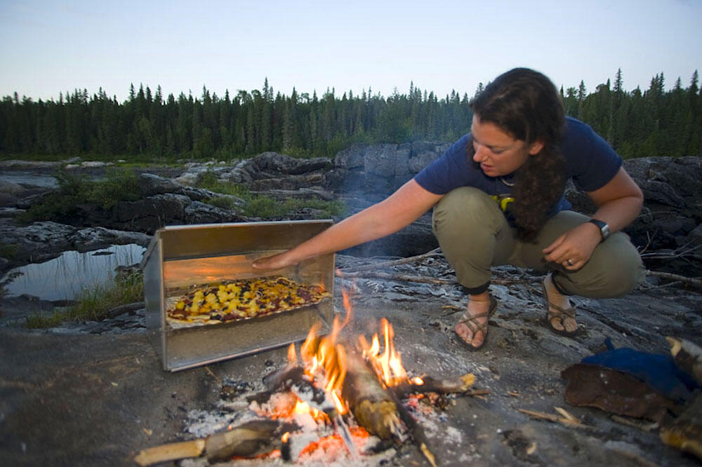 Enjoy delicious gourmet meals cooked over a campfire. | Source: Ontario Tourism