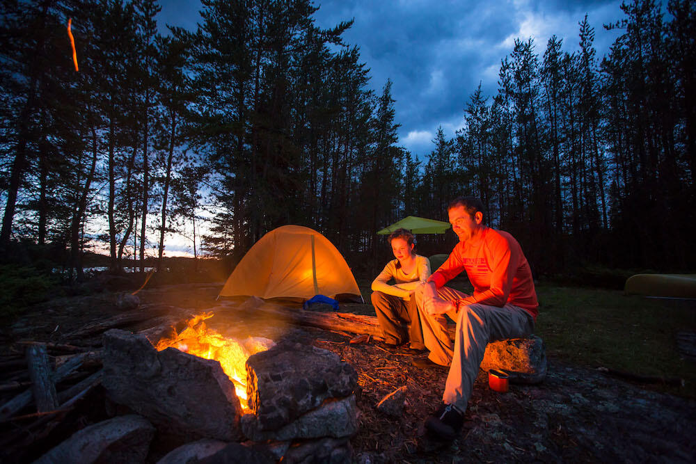 Reflect on the highlights of the day around the campfire. | Source: Ontario Tourism