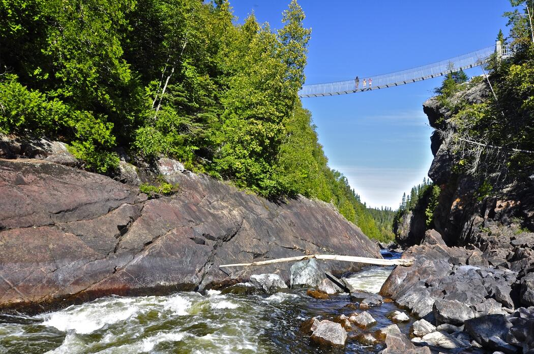 View of suspension bridge from White River