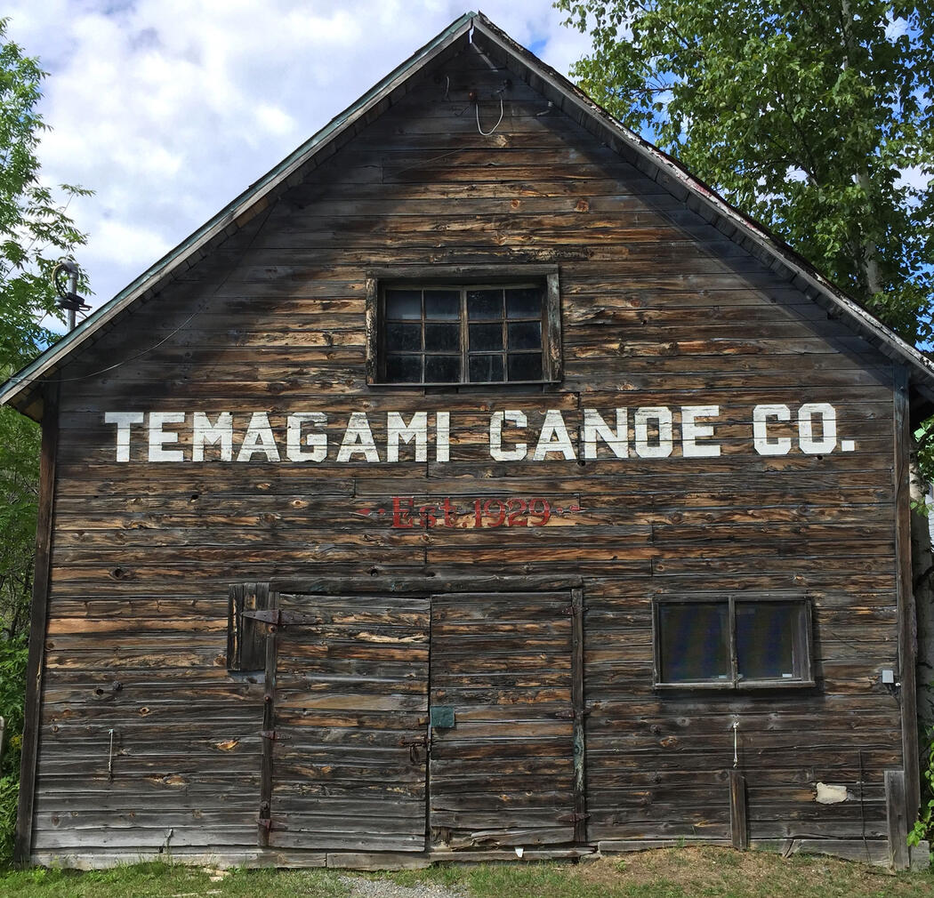 Front of old 2 storey wooden building with Temagami Canoe Co. written on it