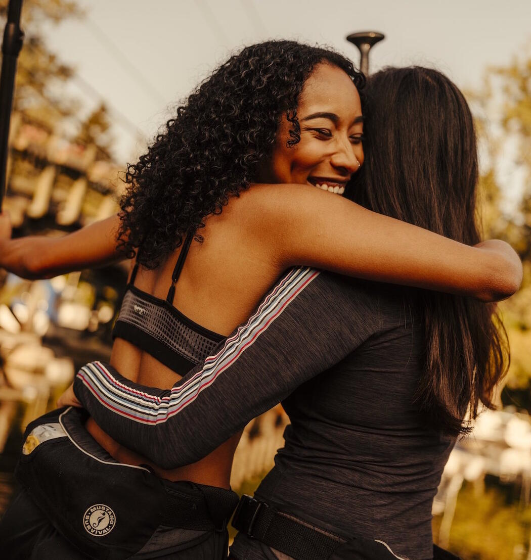 Two woman hugging in victory