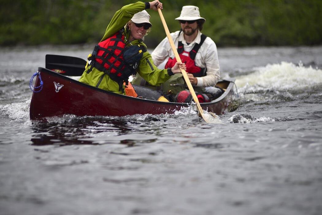 Canoeist doing draw stroke in bow of canoe