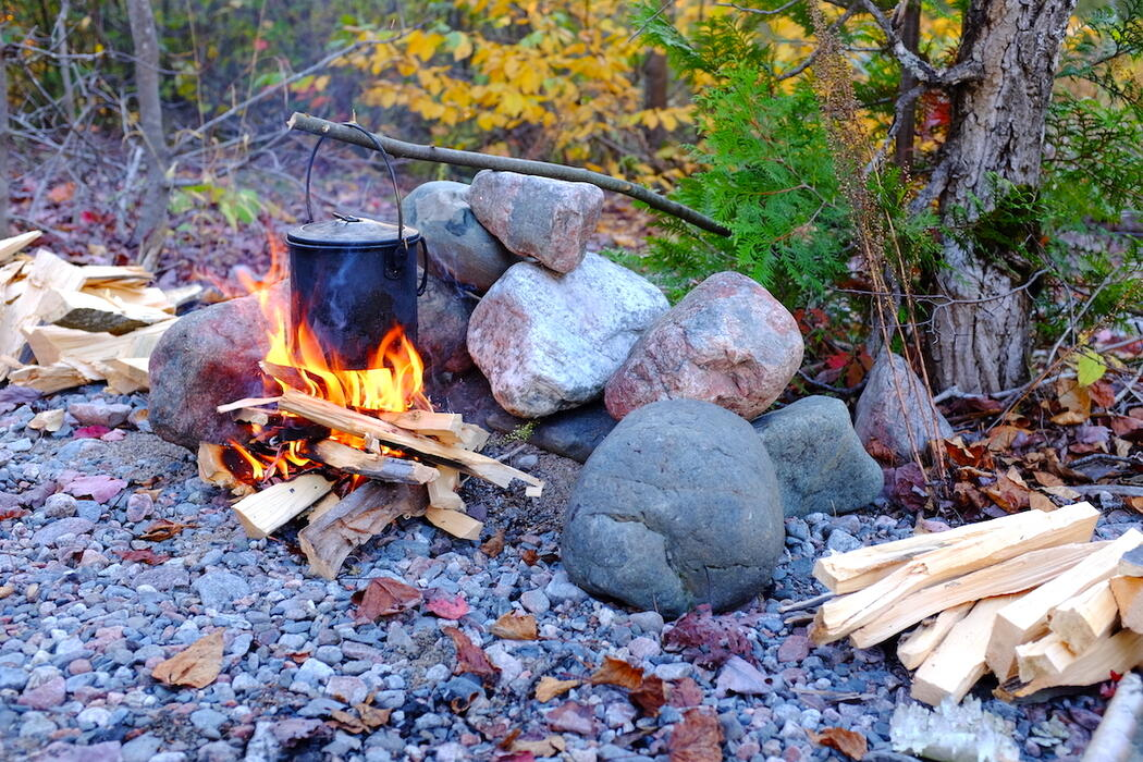 Pot hanging over campfire