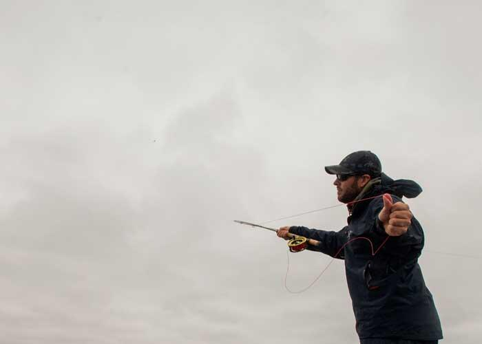 fly fisher casting