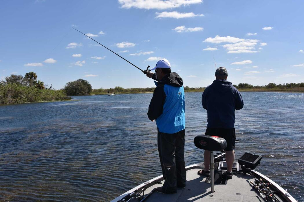 anglers casting from a boat
