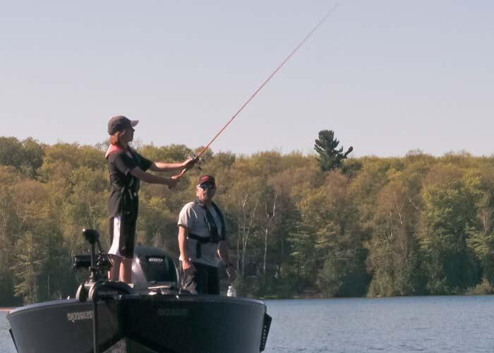 boys fishing from a pinecraft boat