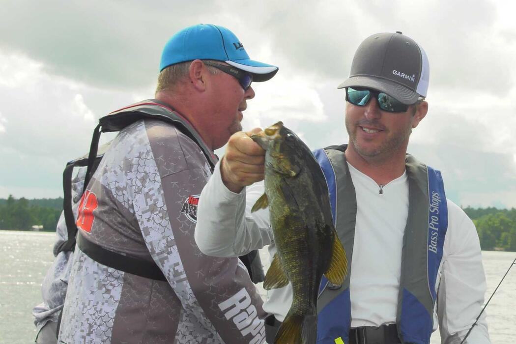 anglers with smallmouth bass