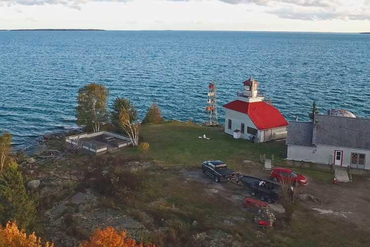 aerial view of bruce bay cottages and lighthouse