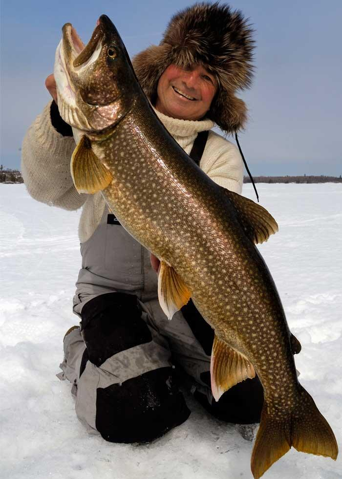 ice angler with lake trout