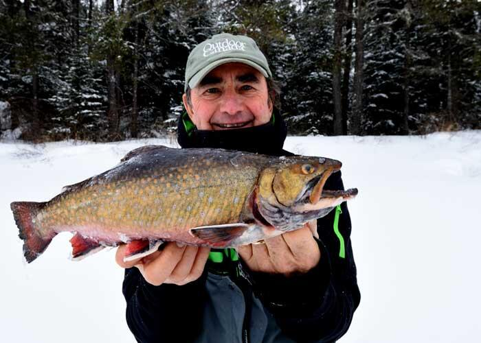 ice angler with trout
