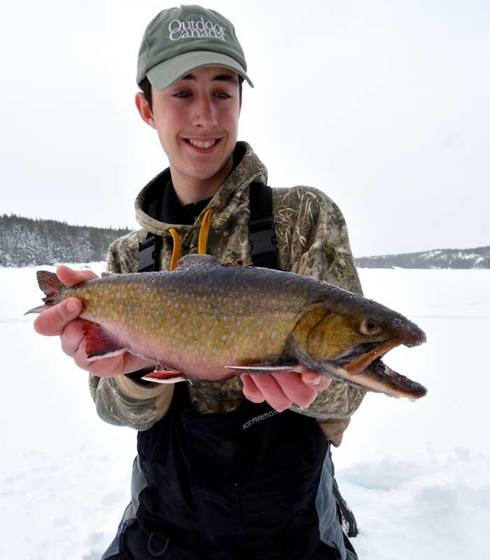 ice angler with speckled trout