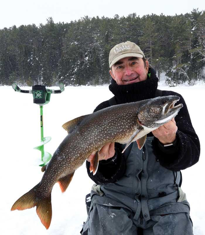 angler with lake trout