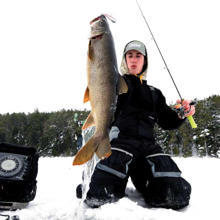 young angler with lake trout