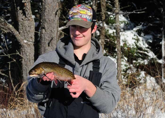 young angler with trout