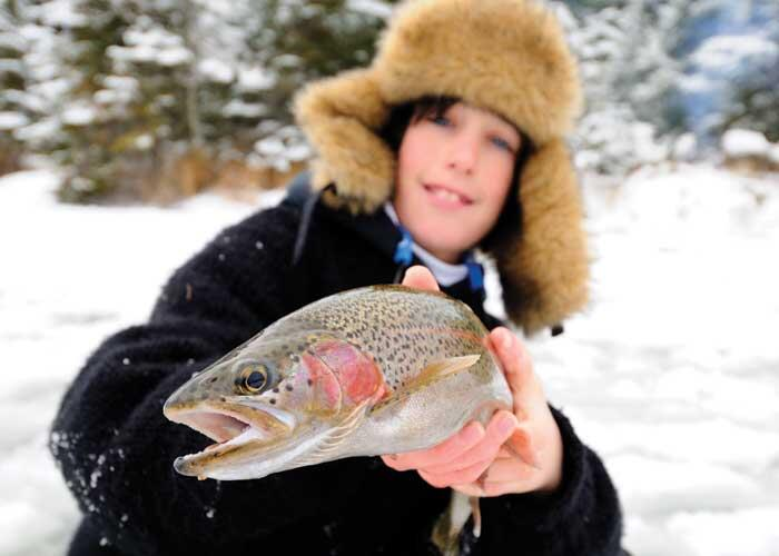 young angler with rainbow trout