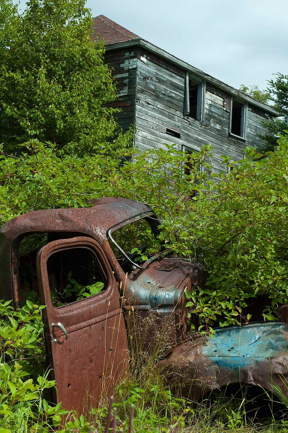 abandoned truck and house