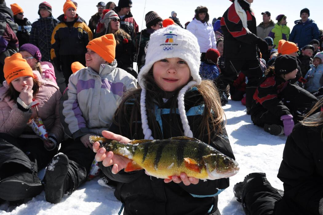 child angler holding perch