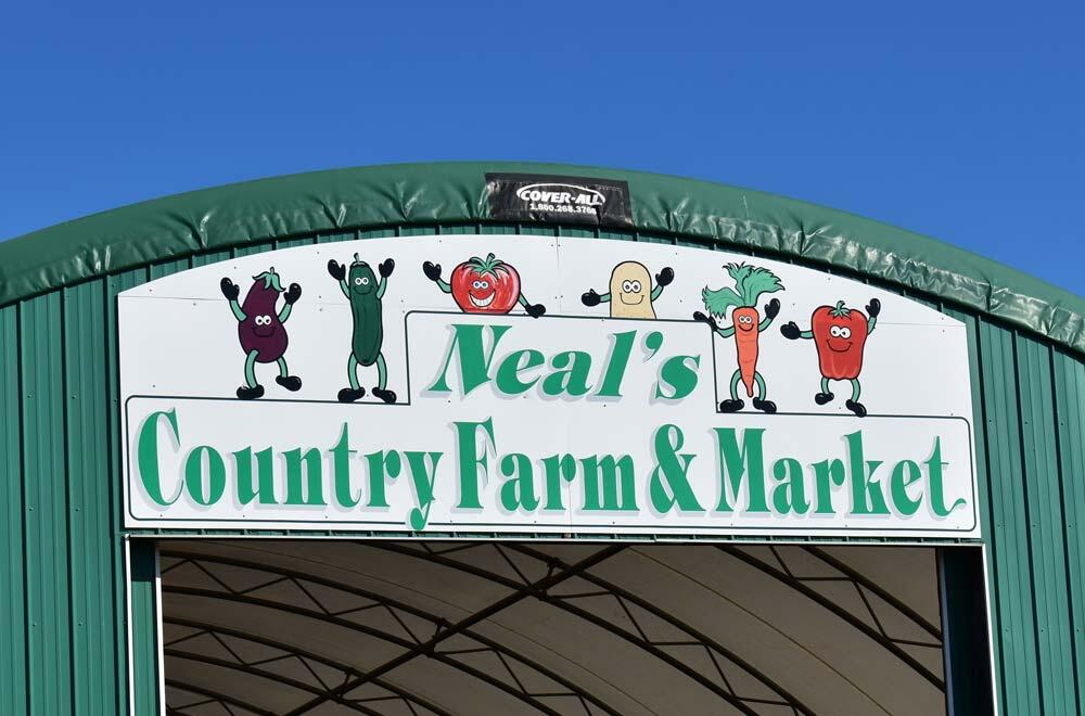 neal's country market sign