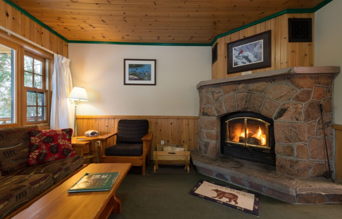 inside a cozy cabin with a wood burning fireplace
