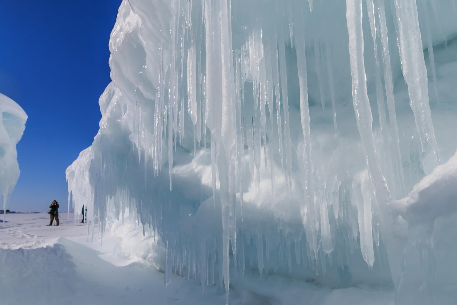 ac525a5f59b47b Ice caves are formed by wave action bashing against the rock walls and  inlets along the shore of Lake Superior. Plummeting temperatures freeze the  layers of ...