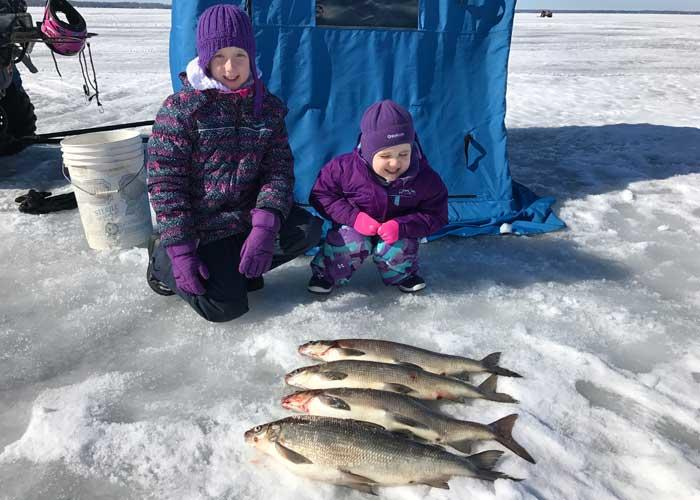 young ice anglers with whitefish