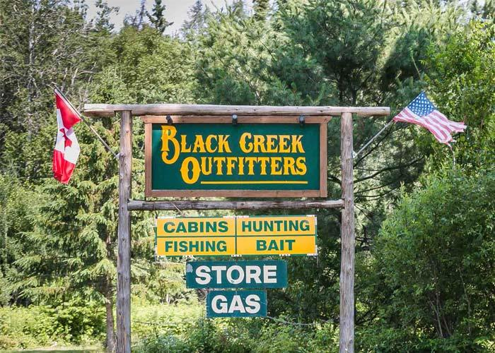 black creek outfitter sign
